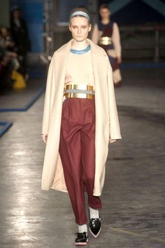 Casual came in the easy silhouettes wit longer lines and fuller proportions, as well as in the camel scheme mixed in with color blocks of burgundy, light blue and black.    - HarpersBAZAAR.com