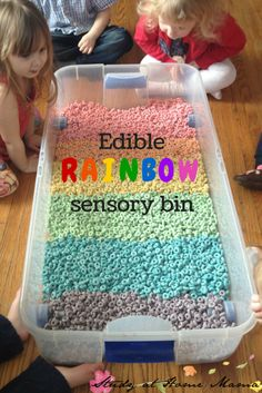 Edible Rainbow Sensory Bin for Toddlers - Froot Loops sensory fun!