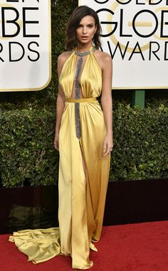 2017 Golden Globes: Emily Ratajkowski is wearing a yellow Reem Acra dress with a plunging neckline and silver embellishments. The dress fits Emily like a glove! Way to rock yellow!