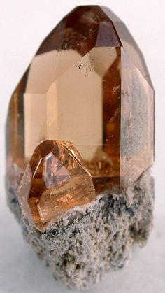 Topaz is a neosilicate mineral. It has a hardness of 8 (Mohs), forms crystals in a wide range of possible colors, and these are prized as gemstones.