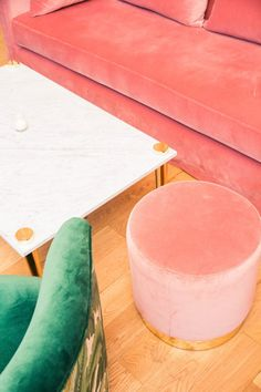 Inside James Morrissey's New Bar The VNYL: Big Pink Couch and Footrest with Green Chair and Marble Coffee Table | coveteur.com
