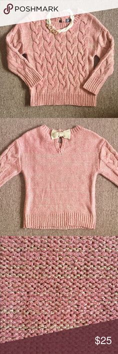 Gorgeous Pink/Gold Cable Knit Sweater I've held on to this sweater believing someday it will fit because I love it that much! Unfortunately it is not going to happen lol. It says it is size L but fits more like a small. Its 3/4 sleeve gold threading throughout, super cute for the holidays especially with the gorgeous bow in the back! In love with it! Sweaters Crew & Scoop Necks