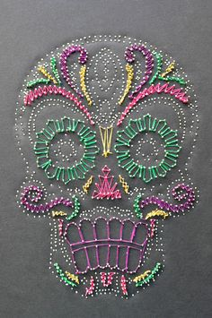 Play off a Día de los Muertos aesthetic but interpret it in a new way. Foam-core was used for the base and standard sewing pins to created the larger image. After that, I used bright thread to fill in the rest of the piece.