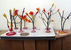 Trees. Simple but very effective (air dry clay, twigs, wool roving)