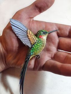 Handmade paper and resin hummingbird sculpture by Zack Mclaughlin.