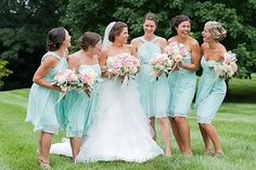 Mint bridesmaids dresses paired with pink rose bouquets made for such a soft look to this wedding. #Bridesmaids #Dresses #Mint