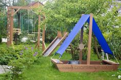 Cool garden playground for kids idea. Rock wall, climbing bars, swings, slide, ship sandbox for little captain and other equipment for active children.