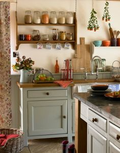 Save space in cupboards by installing open shelving and displaying dry groceries in attractive jars