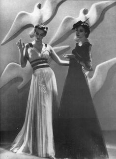 Man Ray for Harper's Bazaar, 1937. Dresses by Chanel. Models standing in front of Giacometti's Albatross, 1927.