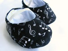 Fun music baby booties for a baby boy or girl in black by bootki