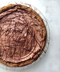 Vegan Chocolate Cream Pie | Hosting vegan guests this holiday season? No need to serve them a separate dessert. Whip up this silky chocolate pie at the holidays, and all of your guests—even your vegan and gluten-free ones—will be able to enjoy it (and trust us, they'll devour it). The press-in crust couldn't be easier—just dump the almond-based mix into your pie pan and press it to the edges. As it bakes, you can make the cr...