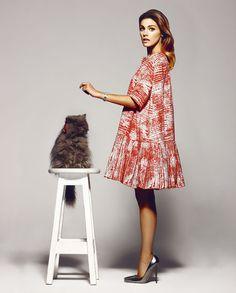 Fashion Pet, Alonso, a Persian cat wears two flowers (Mariana Barturen)  Amaia Salamanca wears Paule Ka coat, Jimmy Choo shoes, watch and silver earrings -Dior