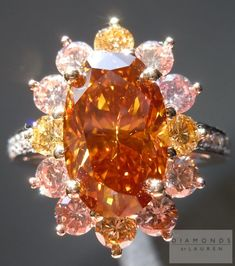 Orange Diamond Ring | pink Halo