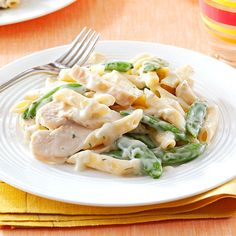 Garlic Chicken Penne Recipe -All it takes is four ingredients and 20 minutes to have this hearty dish ready for the table. Chicken, snap peas and pasta star in this dish, and the garlicky sauce ties it all together nicely. —Anne Nock, Avon Lake, Ohio