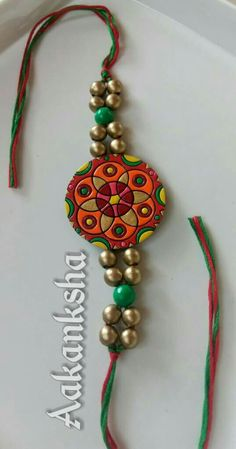 Rakhi from aakanksha terracotta Fancy Jewellery, Thread Jewellery, Clay Jewelry, Terracotta Jewellery Designs, Terracota Jewellery, Rakhi Bracelet, Handmade Rakhi Designs, Rakhi For Brother, Rakhi Making