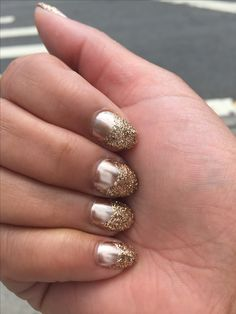 All that glitters is gold  Gold chrome and glitter gel nail.