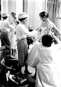 Coco Chanel and Jean Patchett during a fitting, circa 1950-1951.