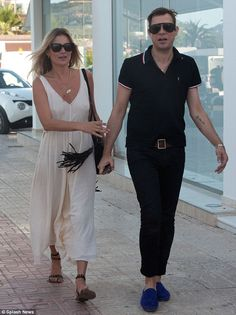Let's eat: Kate Moss and Jamie Hince make their way to a local restaurant in Ibiza on Sund...