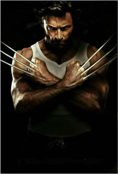 Wolverine flashes his claws, with arms crossed over his chest. adamantiumclaws.com #wolverineclaws #retractablewolverineclaws #adamantiumclaws