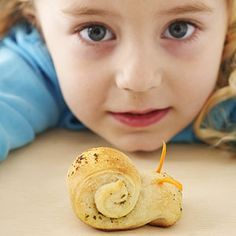 Breadstick dough is seasoned with pesto then rolled up to look like a snail for these fun snacks. Or serve them with soups and salads for dinner.