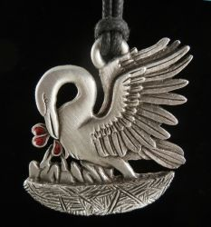 It was ancient belief that, if a pelican was unable to find enough food to feed her young, she would peck at her own breast and feed the drops of blood to her young. It is because of this belief that the pelican has long been a symbol of selflessness and charity. In the 13th century, this figure became widely used in Christian art to represent Christ's voluntary sacrifice.  Cast from LEAD FREE Pewter in our shop in Boise, Idaho.