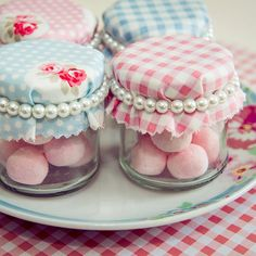 Vintage wedding favour jars. Pink and blue floral and gingham fabrics with pearl bracelet tie.