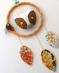 dream catcher (I NEED to make one of these.  Minus the scary looking badger thing in the middle for Maggie.)