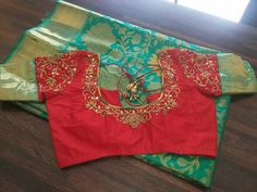 Sea green saree with red embroidered blouse