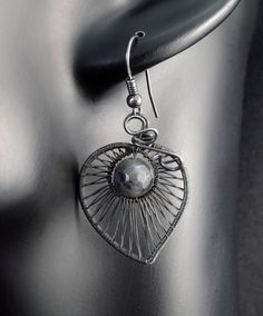 A delicate, unique, handmade, wire wrapped earrings with Larvikite.  Earrings were designed and made by Me, using an extremely labor-intensive and precise wire-wrapping technique, with silver 925, 930 and 999. Whole strongly oxidized and polished.  Dimensions of earrings: length: 4.6 cm (1.81 inch) width: 2,3 cm (0.90 inch)  You receive these unique earrings in jewelry box, so theyre ready to be a gift.   Another items from the collection you may find here:  https://www.etsy.com&#x...