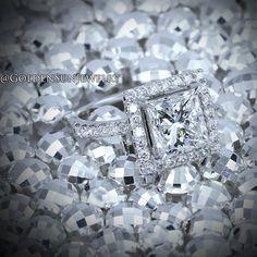 Princess cut diamond halo engagement ring. Designers of fine jewelry since 1988.