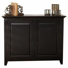 """Black 2-door raised panel buffet.  Product: BuffetConstruction Material: MDFColor: Distressed black Dimensions: 36"""" H x 46"""" W x 14"""" D"""