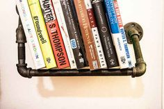 Add an industrial touch by installing a pipe shelf…