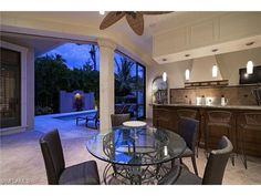 382 N Gulf Shore, Naples, FL 34102 | Gorgeous outdoor living space with bar and pendant lighting.  Olde Naples