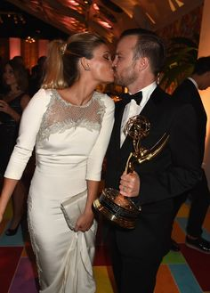 Pin for Later: Relive the Best Moments From the 2014 Emmys  Aaron Paul kissed his wife, Lauren, after his big win.