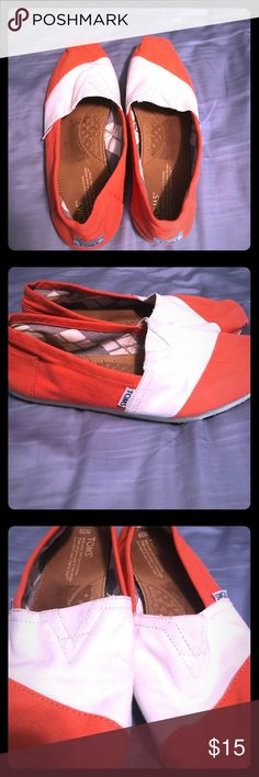 Toms! Orange and white toms. Light wear. Argyle pattern inside. The white has faded a tad, but no bad stains at all. Toms Shoes Flats & Loafers