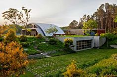 modern house with arc shaped  roof