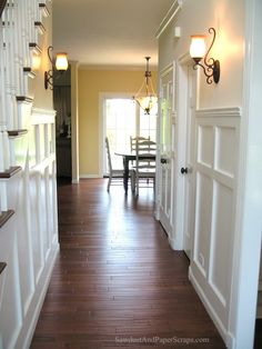 I wanted to brighten up this house and get rid of all of that awful orange wood.  I created this wainscoting by routering a bunch of MDF and nailing it onto the wall.  It was actually a lot of w...