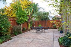 Inspired Stamped Concrete Patio trend San Francisco Traditional Patio Innovative Designs with backyard dining area enclosed yard fence Patio paved patio plants small yard Small Yard Landscaping, Backyard Ideas For Small Yards, Small Backyard Design, Modern Backyard, Small Backyard Landscaping, Backyard Fences, Small Patio, Landscaping Ideas, Backyard Designs