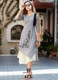 Haute Embroidered Work Faux Georgette Grey Party Wear Kurti Make the heads flip whenever you costume up with this wonderful grey faux georgette party wear kurti. The brilliant dress creates a dramatic canvas with superb embroidered work. Stylish Kurtis Design, Stylish Dress Designs, Stylish Dresses, Dress Neck Designs, Blouse Designs, Fancy Kurti, Kurta Designs Women, Kurti Designs Party Wear, Indian Designer Wear