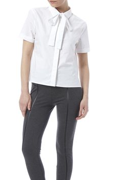 Short sleeve button down top featuring a bow necktie.  White Bowtie Top by English Factory. Clothing - Tops - Blouses & Shirts Clothing - Tops - Short Sleeve New York City