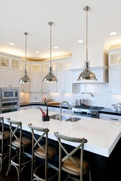 Ooh I likeee this kitchen! (except for the very dark wood - it just needs to be lighter) To see more pics visit http://www.houzz.com/projects/22768/Modified-Telluride-by-Candlelight-Homes