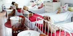 The children sleep dormitory style on the top floor; each has a bin full of toys and a chair for their teddies.