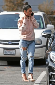 Love Kourtney Kardashian's pink hoodie with ripped thigh jeans look? Here's where to find it for less!Kourtney's style is forever inspiring because...