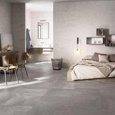 Downtown Light Grey Grey Porcelain Tiles. This beautiful large format tile, creates a subtle and contemporary background for your furnishings that complements any room. With its urban design you can create an industrial and on trend look and feel to your home. https://www.tileflair.co.uk/product/downtown-light-grey #IndustrialDesign #InteriorDesign #GreyTiles #ContemporaryTiles #Tiles #BeautifulTiles #FloorTiles #Grey