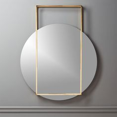 "Shop Pendulum Gold Wall Mirror. A circular mirror appears to hover mid swing in this standout design by Mermelada Estudio. Combining ""balance with the simplicity of geometric forms,"" rectangular brass frame creates open framework for this abstract mirror. Mounting hardware is not included."