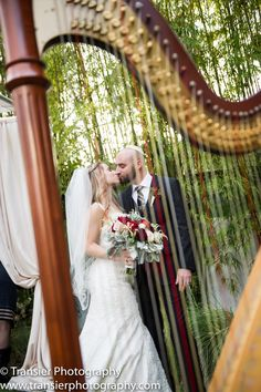 Classic bride and groom through the harp strings! By Transier Photography at Black Dolphin Inn.
