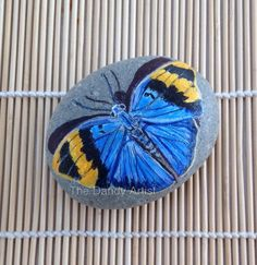 Butterfly pebble art. by TheDandyArtist on Etsy https://www.etsy.com/uk/listing/525799157/butterfly-pebble-art