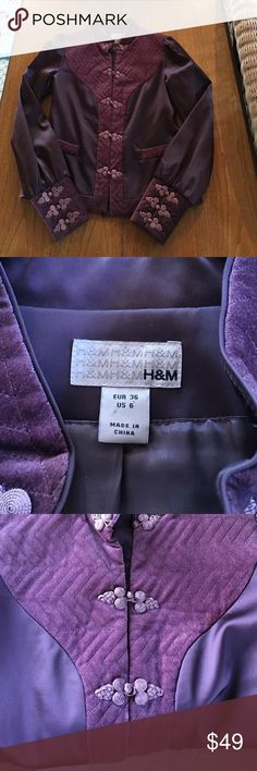 Gorgeous plum H &M jacket This jacket is really special. It is a plum satin with plum velvet detailing on the front, a panel of velvet at the top of the back of the jacket, velvet on the bottom of the sleeves and all the way around the bottom. The closures down the front and on the sleeves are so beautiful! Please see photos.  The color was hard to capture, but I feel like the pictures are accurate. Let me know if you would like to see more photos. H&M Jackets & Coats Blazers
