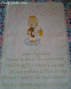 Angelo con poesia ricamato a punto croce