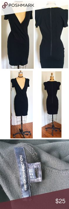 French Connection LBD NWOT French Connection NWOT low deep V neck black dress. Zipper closure up the back. Shoulder pads. See photo for dress materials. Size 8. French Connection Dresses Mini